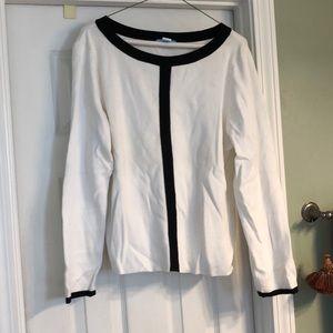 White sweater with black trim